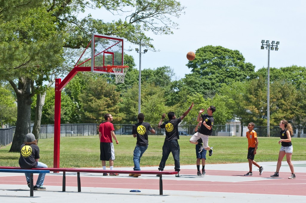 teens playing basketball on new courts at Buttonwood Park