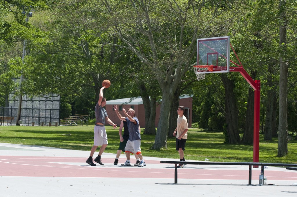 men playing basketball on new courts at Buttonwood Park
