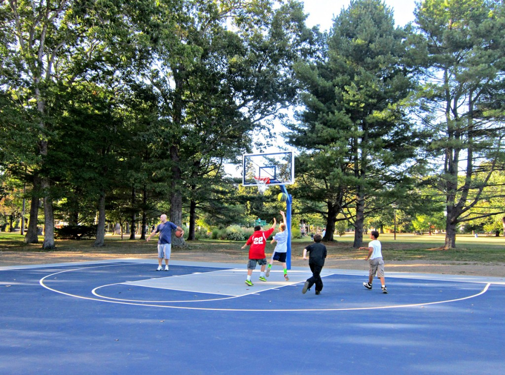 kids playing basketball on new courts at Buttonwood Park