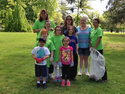 group of kids and adults after a trash cleanup at Buttonwood Park